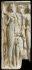 Fragment de relief architectural montrant des divinités égyptiennes, remployé comme dalle funéraire chrétienne